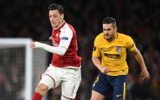 Arsenal's Mesut Ozil (left) in action during the Europa League first leg semi-final match against Atletico Madrid on 26 April 2018. Picture: @MesutOzil1088/Twitter