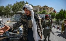 Taliban fighters stand guard along a street at the Massoud Square in Kabul on August 16, 2021. Picture: Wakil Kohsar / AFP