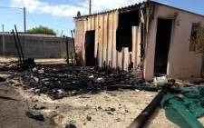 FILE: A house of a man who allegedly raped a three-year-old girl in Delft was torched. Picture: Carmel Loggenberg/EWN.