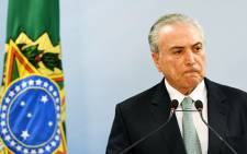 Brazil's President Michel Temer speaks during a press conference following allegations that he gave his blessing to payment of hush money to a politician convicted of corruption. Picture: AFP.