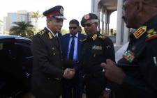FILE: Egypt's Minister of Defence and Military Production Mohamed Ahmed Zaki (L) is welcomed by his Sudanese counterpart Ahmed Awad Ibn Auf (C) in Khartoum on 25 November 2018. Sudan's President Omar al-Bashir in October 2018 lifted a 17-month long ban on agricultural imports from Egypt, during an official visit by Egyptian President Abdel Fattah al-Sisi to Khartoum. Picture: AFP