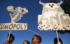 FILE: Protesters hold up two signs during the anti-Zuma march that took place in Cape Town. Picture: Bertram Malgas/EWN.