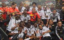 FILE: Orlando Pirates players celebrate after winning the 2012 Carling Black Label Cup at FNB Stadium. Picture: Taurai Maduna/EWN