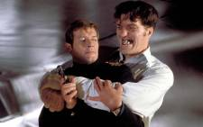 Richard Kiel's character, Jaws, (R) was known as the best villain in James Bond movies. Here he is in a screenshot with Roger Moore from The Spy Who Loved Me.