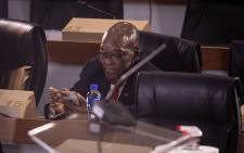 Former President Jacob Zuma checks his phone while at the state capture inquiry in Johannesburg on 17 November 2020. Picture: Abigail Javier/EWN
