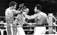 FILE: This file photo taken on October 30, 1974 shows the fight opposing former world heavyweight boxing champion the American Muhammad Ali (R) and his compatriot and titleholder George Foreman (L) in Kinshasa. Picture: AFP.