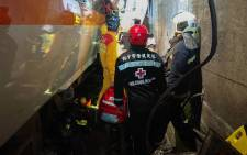 This handout picture taken and released on 2 April 2021 by Taiwan Red Cross shows rescue teams at the site where a train derailed inside a tunnel in the mountains of Hualien, eastern Taiwan. Picture: TAIWAN RED CROSS / AFP