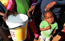 People queue for water in the township of Boitumelong in Bloemhof on 29 May, 2014. Picture: Sapa.