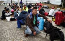 Venezuelan migrants rest on their way to Peru in Tulcan, Ecuador, after crossing from Colombia, on 21 August, 2018. Picture: AFP