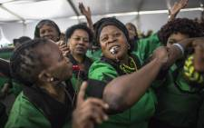 African National Congress Women's League members dance during celebrations for the 80th birthday of ANC stalwart Winnie Madikizela Mandela on 26 September 2016 in Soweto. Picture: AFP.