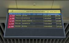 A Departures electronic panel indicating that all flights are cancelled is seen on 14 March 2019 at the Maputo International Airport in Mozambique. Mozambique suspended all domestic flights as it is hit by the largest cyclone in decade. Picture: AFP