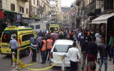 FILE: Egyptians gather near a church in Alexandria after a bomb blast struck worshippers gathering to celebrate Palm Sunday on 9 April 2017. Picture: AFP.