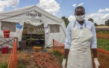 A medical personnel stands in front of a ward of a Cholera Treatment Centre, funded by the Unicef, Malawi Red Cross and UK Aid, at Bwaila Hospital in the capital Lilongwe, Malawi, 25 January 2018. Picture: AFP