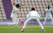 England's Joe Denly (L) plays a shot on the first day of the first Test cricket match between England and the West Indies at the Ageas Bowl in Southampton, southwest England on 8 July 2020. Picture: AFP