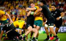 New Zealand's Ardie Savea (R) tackles Australia's Michael Hooper during the Tri-Nations and Bledisloe Cup rugby match in Brisbane on 7 November 2020. Picture: AFP