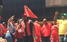 Cosatu president S'dumo Dlamini addresses supporters as workers join him in singing 'Umshini Wam' at the mass march in Johannesburg on 7 October. Picture: Govan Whittles/EWN.