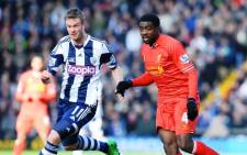 Liverpool defender Kolo Toure (R) vies with West Bromwich Albion midfielder Chris Brunt (L) during an English Premier League football match on 2 February. Picture:AFP.