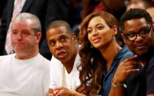 Jay-Z and Beyonce attend Game Four of the Eastern Conference Semifinals during the 2014 NBA Playoffs at the Barclays Center on 12 May 2014. Picture: AFP.