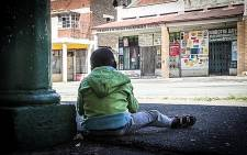 A Malvern child sits and plays meters away from where a 10-year-old died of his injuries after being hit, allegedly by his 10-year-old friend,on the back of his head with a steel rod. Picture: Reinart Toerien/EWN