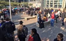 Queues outside Sandton Gautrain station as trains between Sandton and Park Station experience technical issues Park this morning. Picture: Aki Anastasiou/EWN.""