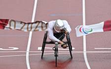 Switzerland's Marcel Hug crosses the finish line to win the men's marathon T54 athletics event during the Tokyo 2020 Paralympic Games on 5 September 2021. Picture: AFP