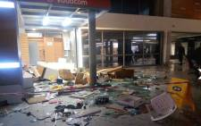 Chaos erupted at the Cape Town train station on 12 June following train delays. At least two train coaches were torched and several shops were damaged by angry commuters. Picture: Shimoney Regter/EWN