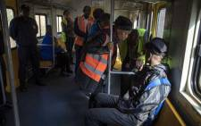 A commuter is interrogated by a Prasa official about his ticket on 28 May 2018. Picture: Thomas Holder/EWN