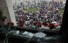 Red carnations have been left in homage to the victims inside the burned trade union building in the southern Ukranian city of Odessa on May 4, 2014. Picture: AFP.