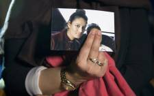 In this file photo taken on 22 February 2015 Renu Begum, eldest sister of British girl Shamima Begum, holds a picture of her sister while being interviewed by the media in central London. Picture: AFP