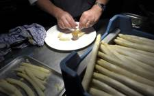 FILE PICTURE: Chef preparing some asparagus. Picture: AFP