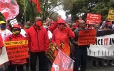 SACP deputy general secretary Solly Mapaila and Cosatu president Zingiswa Losi lead striking workers in Pretoria on 7 October 2020. Picture: Theto Mahlakoana/EWN
