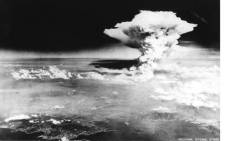 This handout picture taken on August 6, 1945 by US Army and released from Hiroshima Peace Memorial Museum shows a mushroom cloud of the atomic bomb dropped by B-29 bomber Enola Gay over the city of Hiroshima. Picture: AFP.