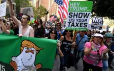 "Protestors take part in the ""Tax March"" to call on US President Donald Trump to release his tax records in Los Angeles, California on April 15, 2017. Picture: AFP"