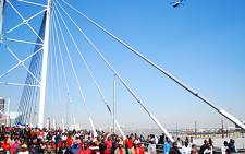 A helicopter flies over protesting municipal workers on the Nelson Mandela bridge in the Joburg CBD on 27 July, 2009. Picture: Taurai Maduna/Eyewitness News