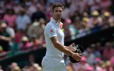 England's batsman Kevin Pietersen walks back towards the dressing room following his dismissal off the bowling of Ryan Harris on the third day of the fifth Ashes cricket Test at the Sydney Cricket Ground on  5 January, 2014. Picture: AFP