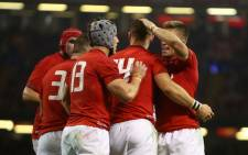 Wales players celebrate a try. Picture: AFP