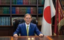 Japan's newly elected Prime Minister Yoshihide Suga poses for a portrait at his office following a press conference at the ruling Liberal Democratic Party's (LDP) headquarters in Tokyo on 14 September 2020. Picture: AFP
