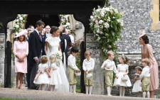 Catherine, Duchess of Cambridge, with her children Prince George and Princess Charlotte at the wedding of her sister Pippa Middleton. Picture: AFP.