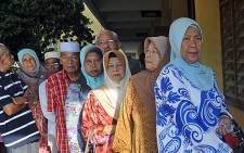 Malaysians queue outside a polling station to cast their vote in Pekan on 5 May 2013. Picture: AFP