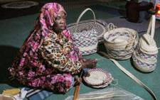In front of a bundle of palm fronds, Halima Mohamad squats down to weave in an abandoned school in Tawergha, a town once a flashpoint in Libya's decade-long war. Picture: AFP.