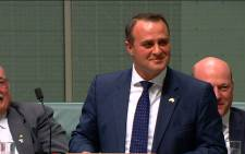 In this TV grab released by Australian Parliament via Seven News, Australian lawmaker Tim Wilson (C) proposes to his partner Ryan Bolger (not pictured) in parliament in Canberra on December 4, 2017.  Picture: AFP