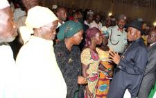 FILE: Nigerian President Goodluck Jonathan (R) speaks to some of the Chibok schoolgirls who escaped Islamist captors and relatives of the hostages during a meeting at the presidency in Abuja on 22 July, 2014. Picture: AFP.