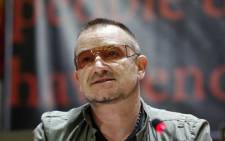 Bono wants to urge US politicians to continue funding programmes that help NGOs.