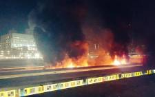 Metrorail train carriages on fire at the Cape Town Station on 9 April 2016. Picture: Twitter: @CapeTalk
