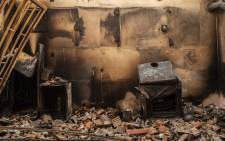 This photograph shows the inside of a burnt house following a wildfire in the village of Kastri on Evia (Euboea) island, on August 10, 2021. Nearly 900 firefighters, reinforced overnight with fresh arrivals from abroad, were deployed on the country's second largest island as major towns and resorts remained under threat from a fire that has been burning for eight days.