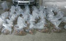 Police on 21 October 2020 arrested two suspects aged 29 and 45 for the possession of shucked abalone worth an estimated R7 million in Milnerton. Picture: @SAPoliceService/Twitter