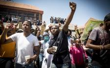 Secretary for the EFF at the University of Pretoria holds up his fist during protest at the institution's Hatfield campus over possible fee hikes for the 2017 year. Picture: Reinart Toerien/EWN.