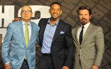 US director Barry Sonnenfeld poses with actors Will Smith and Josh Brolin while promoting their new film Men in Black 3. Picture: AFP