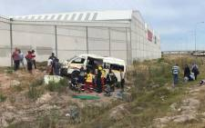 Paramedics assist passengers from a crashed taxi in Mitchells Plain, Cape Town on 6 February 2018. Picture: @ER24EMS/Twitter