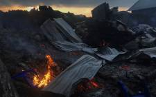 Smoldering ashes are seen early morning in Goma in the East of the Democratic Republic of Congo on 23 May 2021 following the eruption of Mount Nyiragongo. Picture: Moses Sawasawa / AFP
